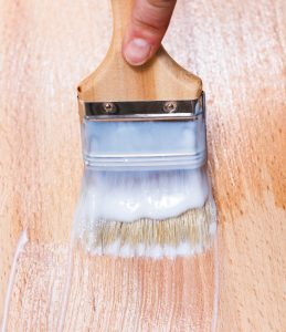 lacquering of surface of beech table top by paint brush