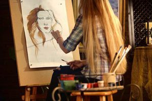 Artist Painting on Easel