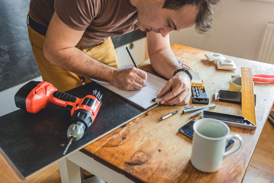 Man making draft plan using pencil on the table