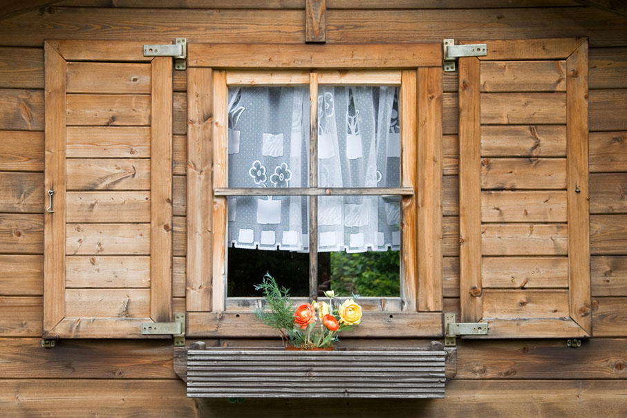 window with wooden shutter exterior